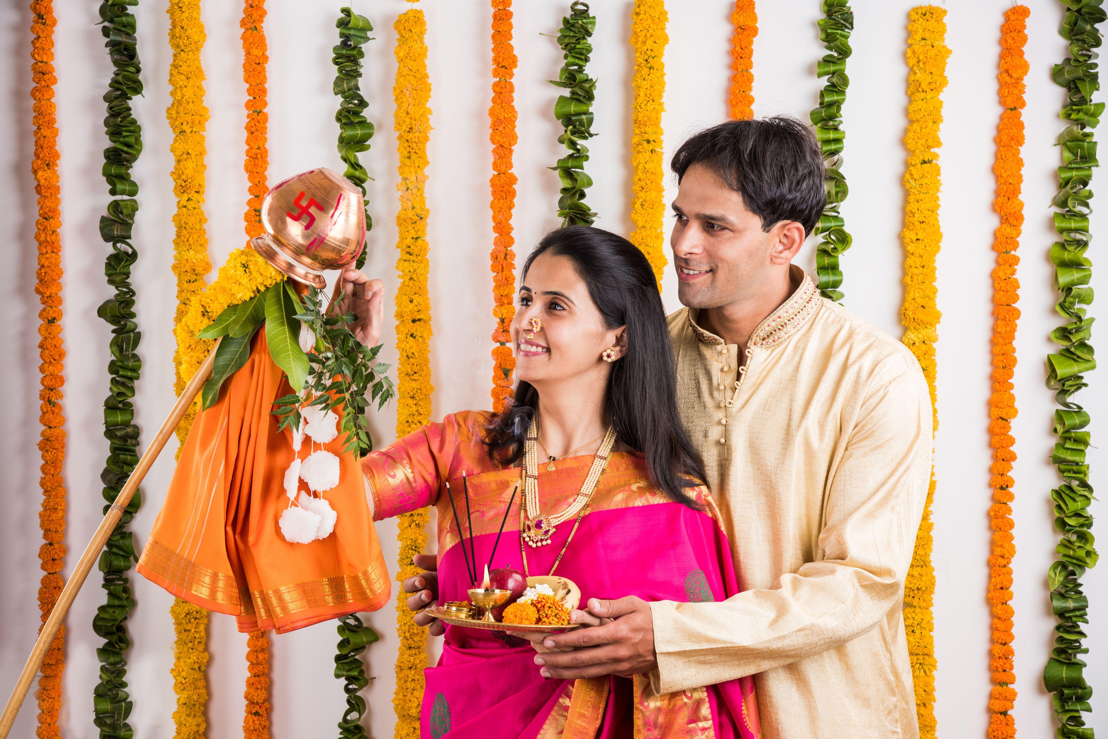 smart indian couple performing gudhi padwa puja