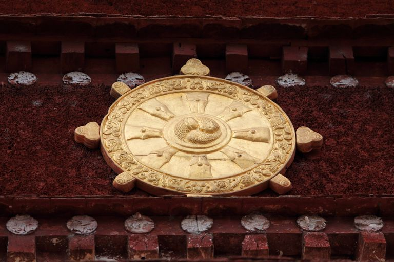 Dharma wheel in Tibetan monastery
