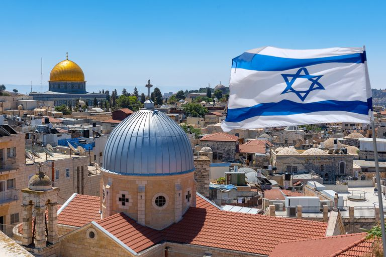 Israeli flag flying over the city of Jerusalem