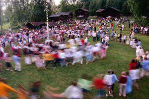 Ringdances around Midsummer pole at Gammelgarden open-air museum.