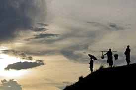 Monks standing on a hillside