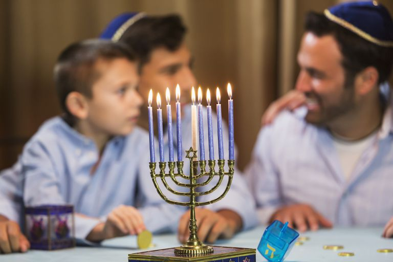 Father and sons with menorah