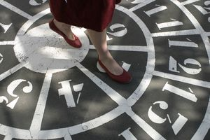 Woman Walking Over Numbers