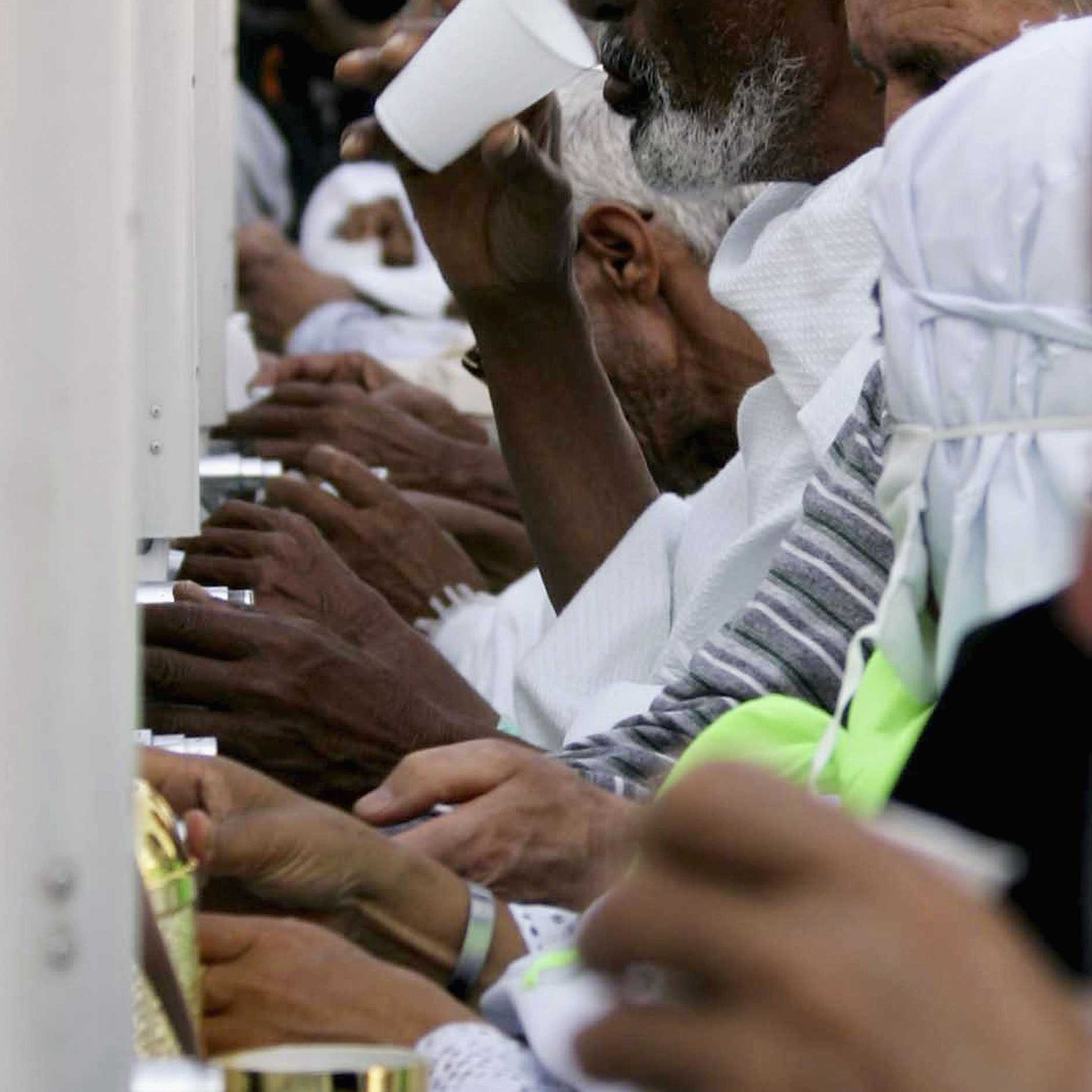 Muslim pilgrims drink water from the Zamzam well the source of which comes from under the great mosque