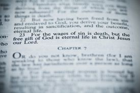 The Bible Open to Romans 6:23