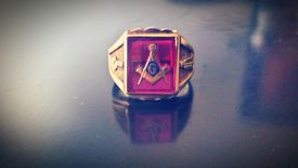 Close-Up Of Freemasons Ring On Table