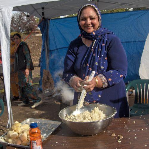 Woman Preparing Langar (Free Food) to serve at the Yuba City Sikh Parade Route