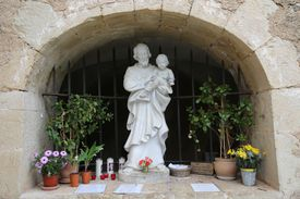 Statue of St. Joseph surrounded by potted plants