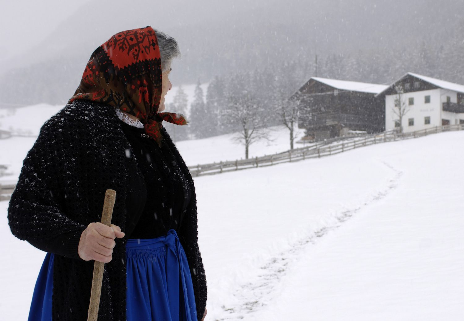 Woman standing in snowstorm