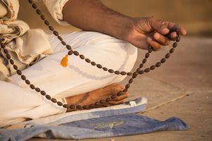 Prayer beads, a man meditating, Varanasi, India