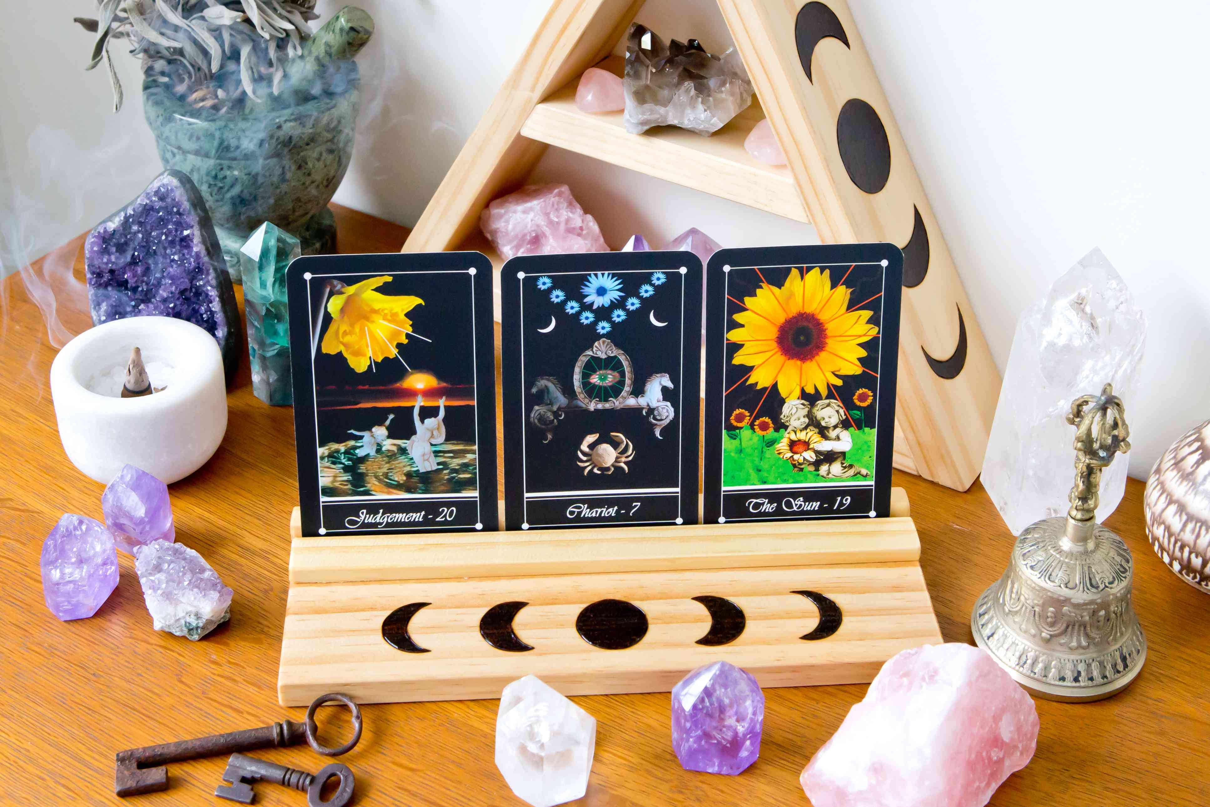 Tarot Cards on stand in Altar space with Moon phase design