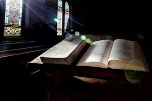 Sunlight Falling On Bibles In a Church.