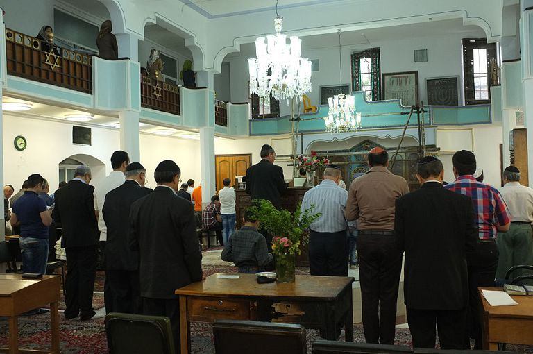 Men praying the maariv service in Judaism.