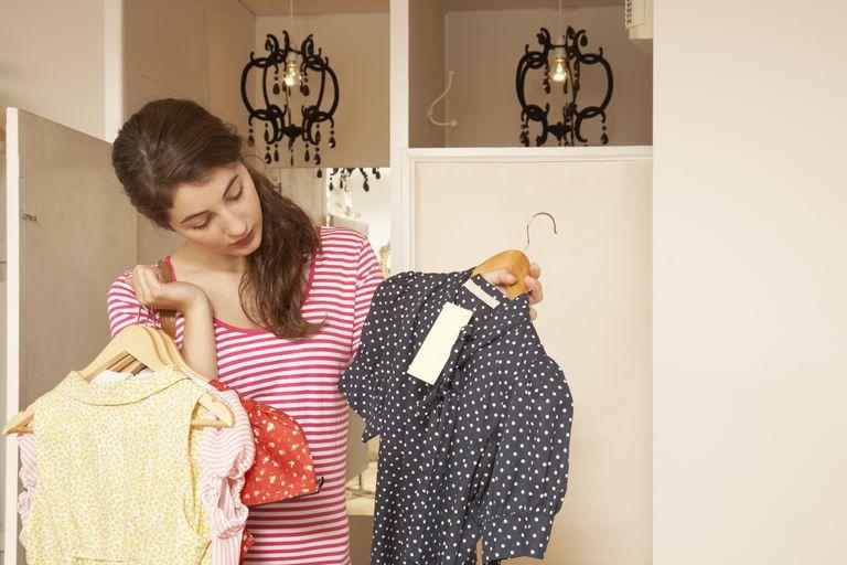 Teenage girl choosing clothes in shop