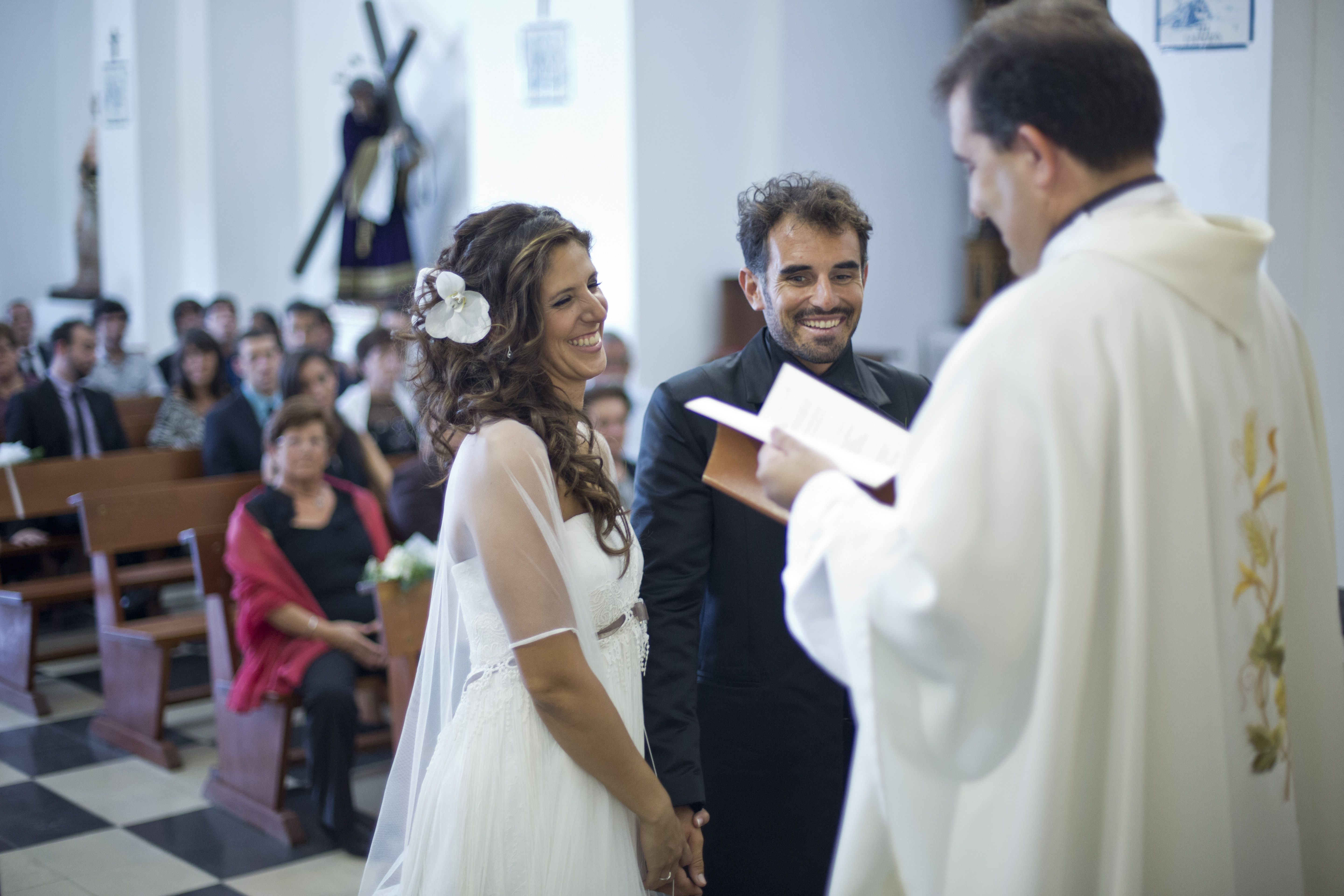 A Catholic bride and groom exchange vows.