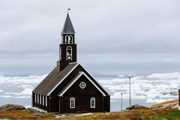 Ilulissat black church and icebergs