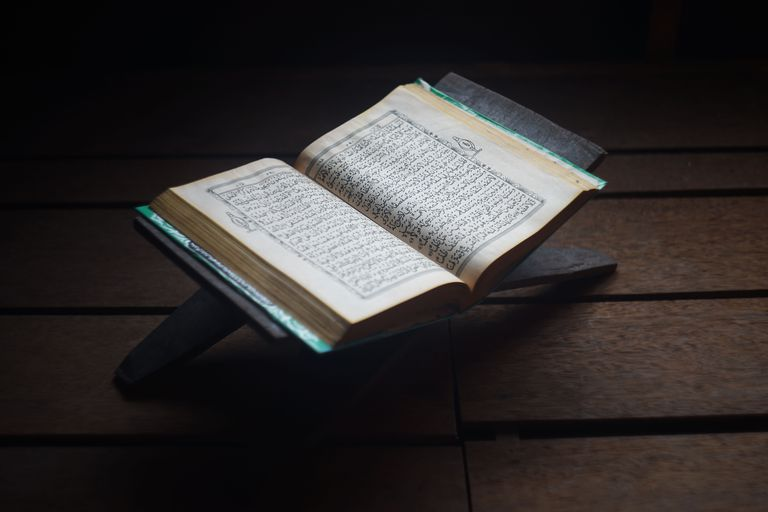 High Angle View Of Koran With Rehal On Hardwood Floor
