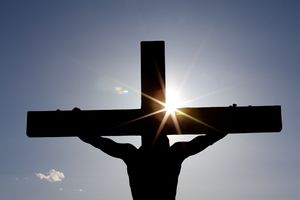 Crucifixion silhouetted in the sun