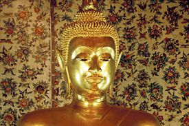 This golden Buddha figurine is a common sight in Asia.