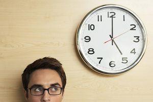Man looking at a clock