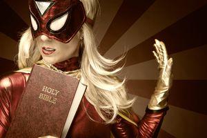 Female Superhero holding Bible.