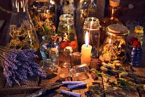 Herbs and candles on altar