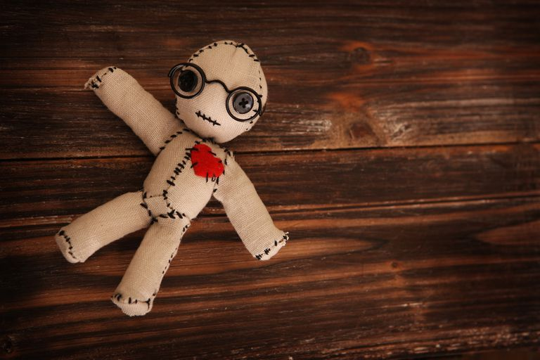 Magical poppet with heart and glasses