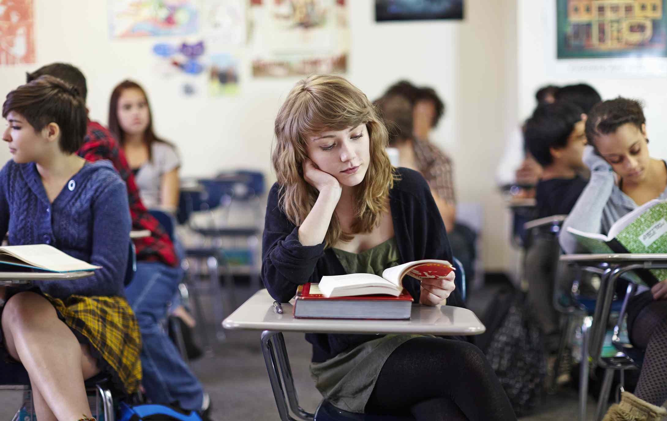 High school students reading in class