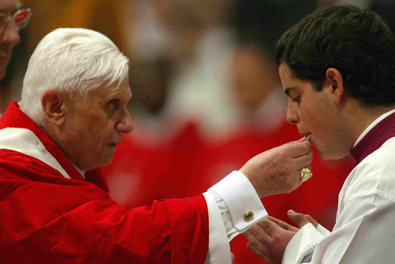 Pope Benedict XVI provides Holy Communion