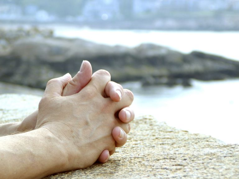 a person's clasped hands as if in prayer