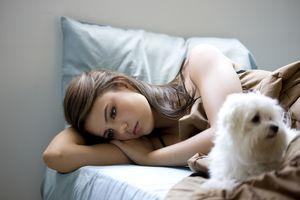 Sad girl with her dog