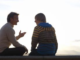 Father having conversation with teen son