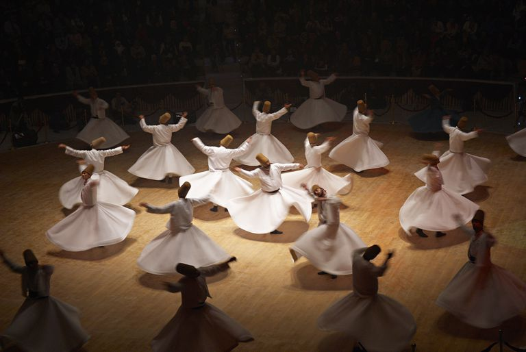 Whirling Dervishes dancing together in Turkey.