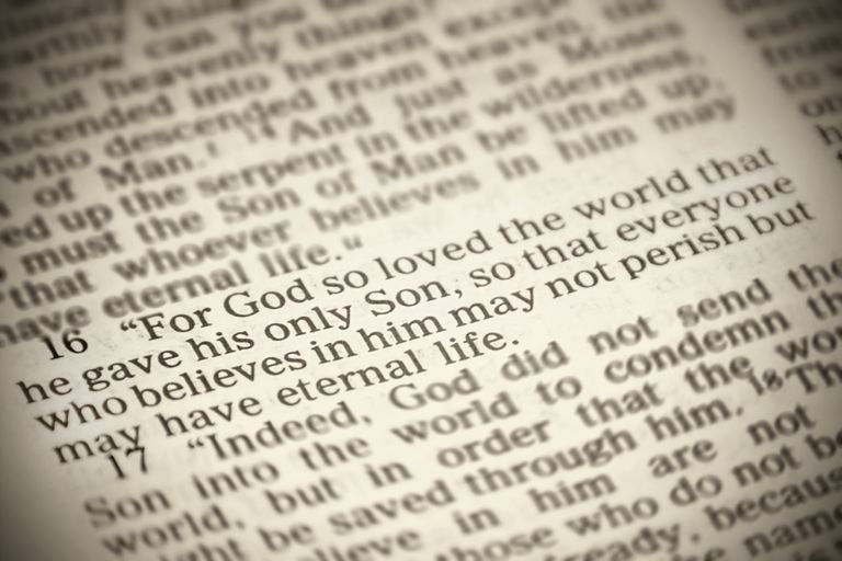 The famous John 3:16 Bible verse, 'For God so loved the world that he gave his one and only Son...' with a sepia tone.