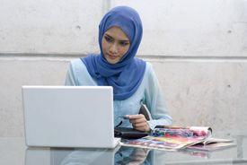 A Muslim woman shopping online