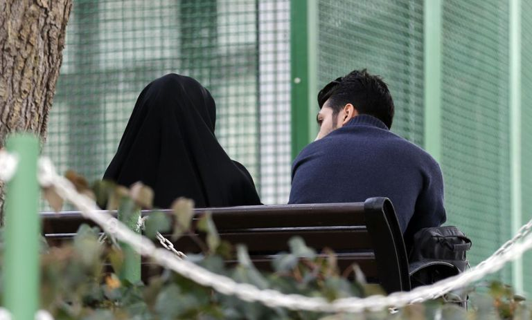 An Iranian couple sit in a park in the capital Tehran