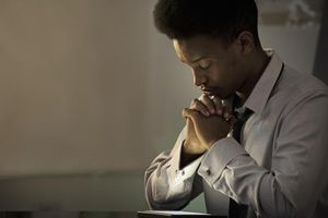 A man praying to overcome his worry