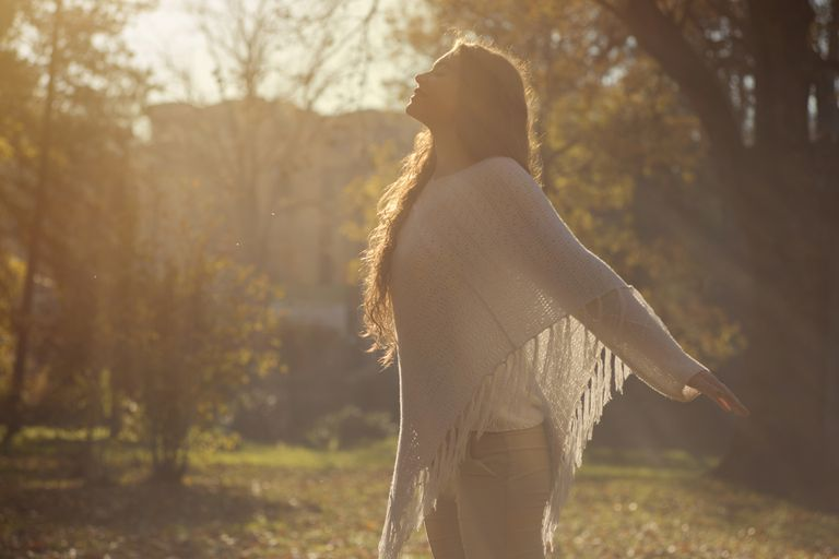 Woman outdoors in the sunshine