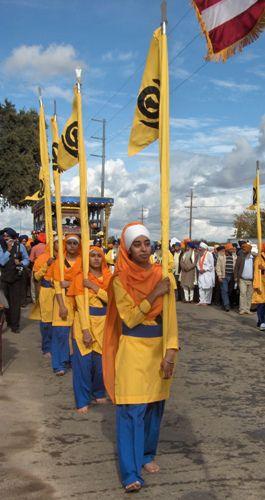 Female Panj Pyara Carry Nishan, the Sikh Flag