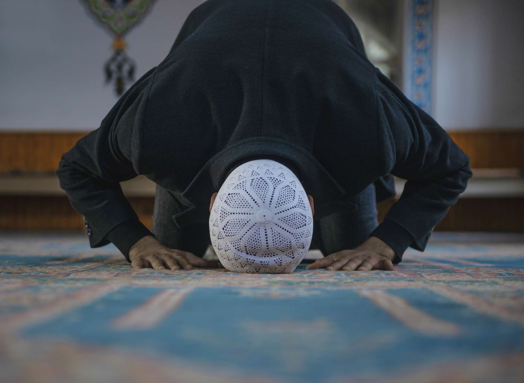 Muslim young man worshiping in a mosque