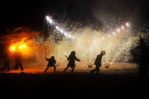 Enthusiasts with torches and fireworks during the Marsden Imbolc Fire Festival 2012