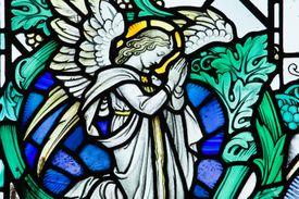 Stained glass window in St. Grwst Church