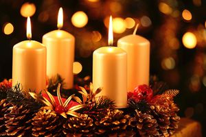 Advent wreath with three burning candles.