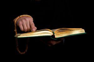 Man reading from the Quaran