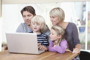 kids and parents around a laptop