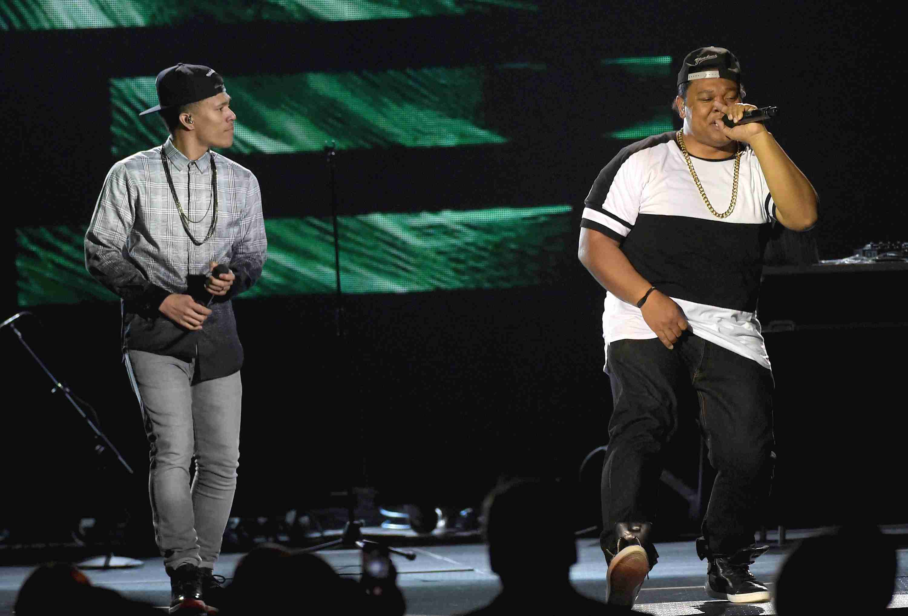 Trip Lee (L) performs on stage with Tedashii at the Annual Dove Awards.