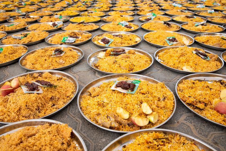 Plates of food waiting to be distributed in a local mosque as part of Ramadan charity.