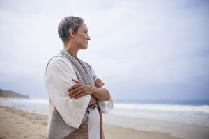Thoughtful woman on beach
