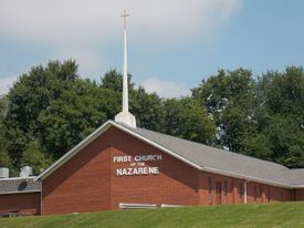 Nazarene church on a partly cloudy day.