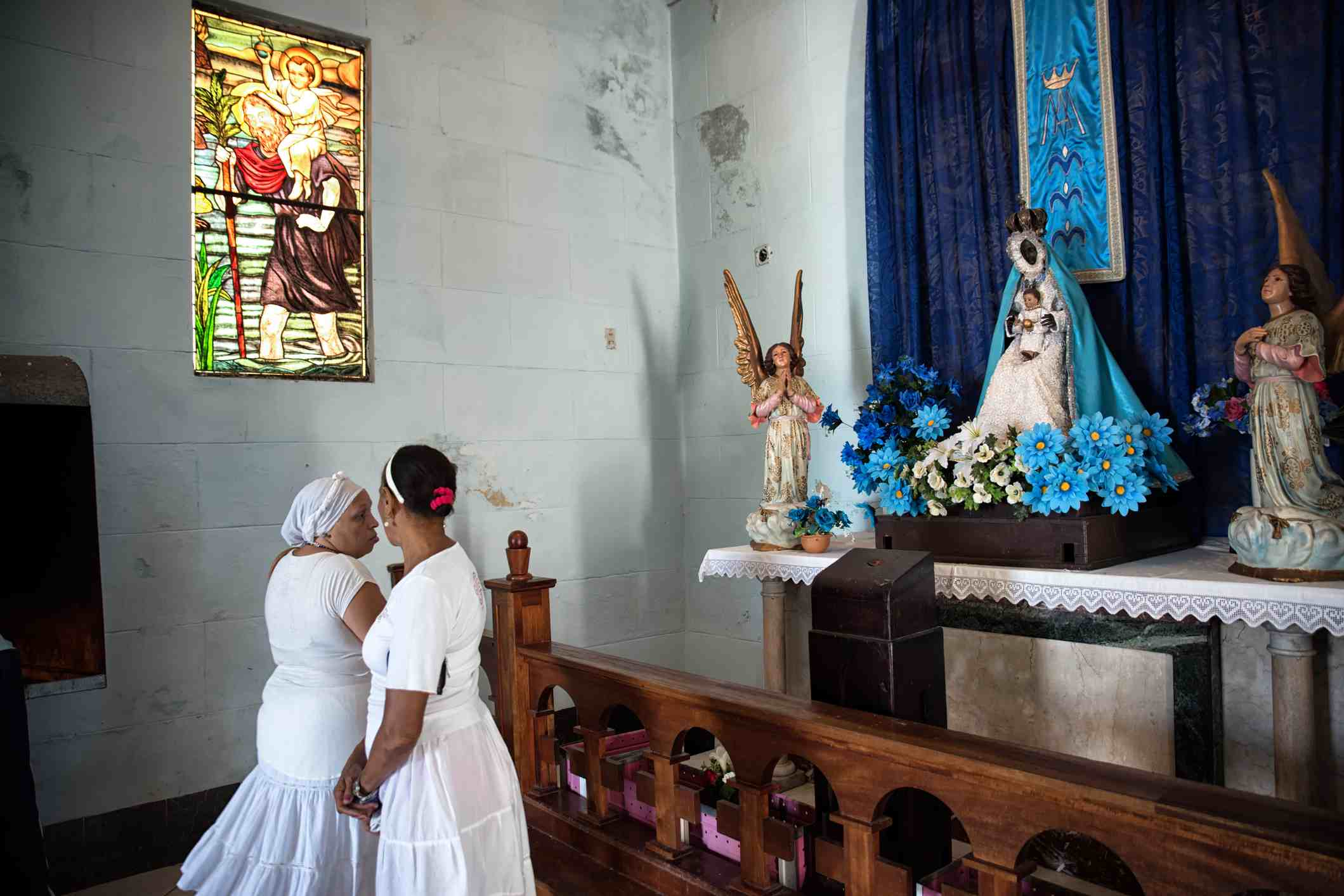 Santeria women in the Our Lady of the Regla church, in Havana, Cuba